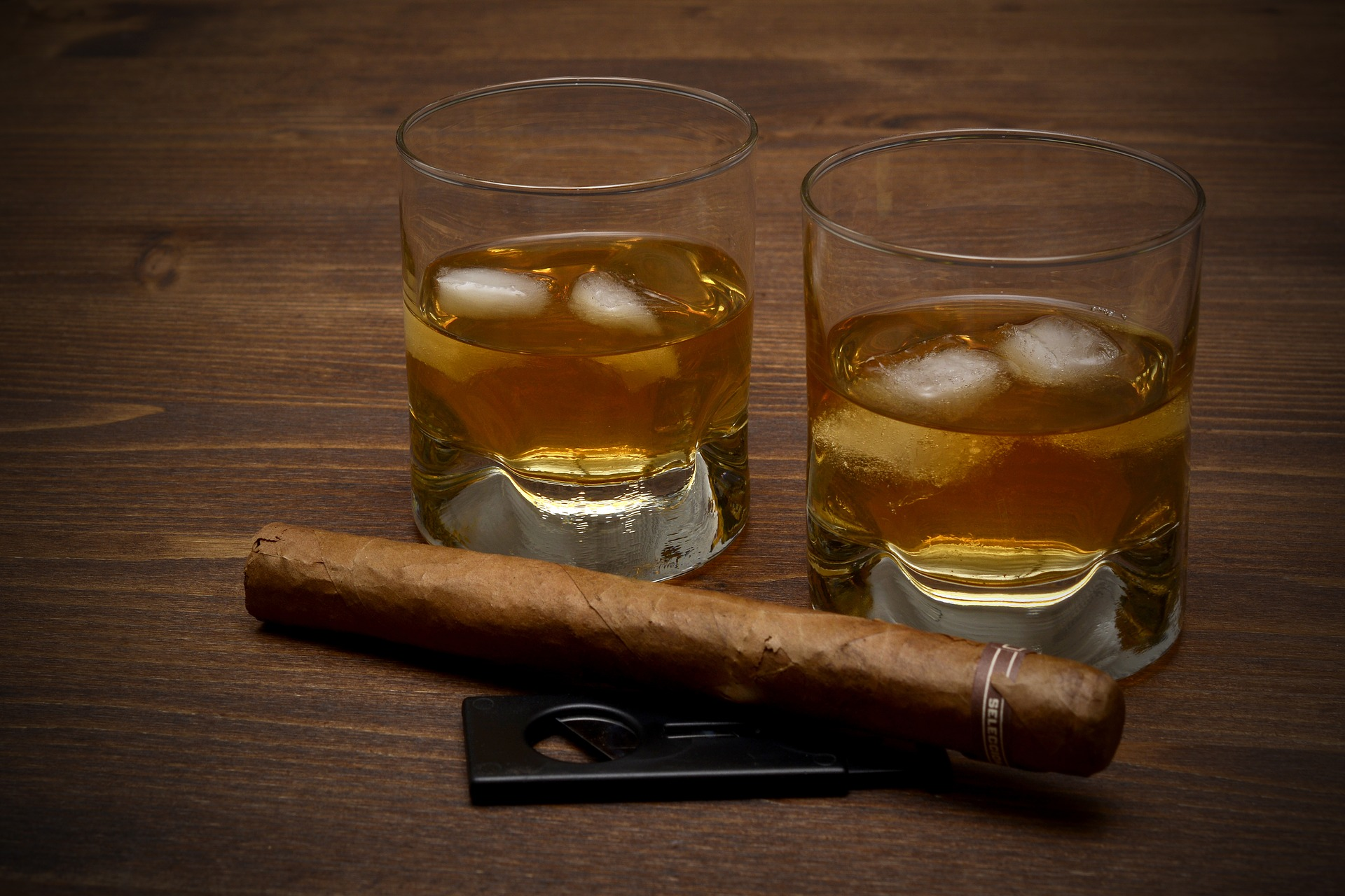 Whisky glasses and cigar